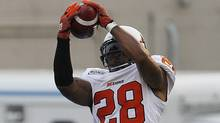 B.C. Lions' Byron Parker intercepts a touchdown pass intended for Winnipeg Blue Bombers' Clarence Denmark during the first half of their CFL game in Winnipeg Friday, August 24, 2012. (The Canadian Press)