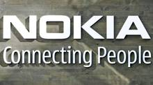 Nokia's corporate logo hangs on a wall at the company's world headquarters in Helsinki in this July 9, 2008 file photo (BOB STRONG/Bob Strong/Reuters)