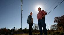 RipNet CEO Kingsley Grant (right) and CFO Eric Rothschild stand next to one of the company's wireless tower near Brockville, Ont. (DAVE CHAN/DAVE CHAN FOR THE GLOBE AND MAIL)