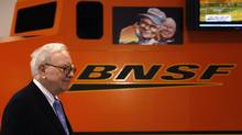 Berkshire Hathaway chairman Warren Buffett walks by a mock BNSF railroad engine at the Berkshire Hathaway annual meeting in Omaha in this May 1, 2010 file photo. (RICK WILKING/REUTERS)