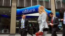People walk by a Citibank office in midtown Manhattan on April 19, 2010 in New York City. (Spencer Platt/Getty Images)