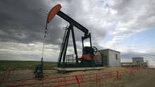 An Encana pump jack pumps oil out of the ground near Rockyford, Alta. (TODD KOROL/REUTERS)