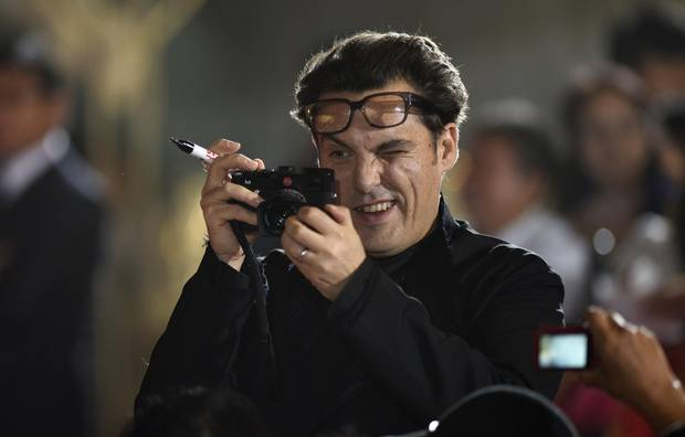 British director Joe Wright takes pictures of fans during the Japanese premiere of his movie Pan in Tokyo in 2015. The filmmaker is probably best known for his costume dramas with literary credentials.