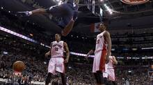 Toronto Raptors forward Rudy Gay (22) and guard DeMar DeRozan (10) react as Memphis Grizzlies guard Tony Allen (9) slams home a dunk during first half NBA action in Toronto on Wednesday February 20, 2013. (Frank Gunn/THE CANADIAN PRESS)