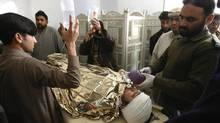 Anti-polio drive campaign worker Hilal Khan is treated at Lady Reading Hospital in Peshawar, Pakistan after being shot by unidentified gunmen, Dec. 19, 2012. (KHURAM PARVEZ/REUTERS)