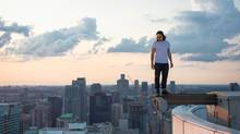 Photographer Tom Ryaboi is one of the pioneers of rooftopping, whose advocates evade security guards, dogs, even urban falcons defending their nests. (TOM RYABOI/BARCROFT MEDIA/LANDOV)