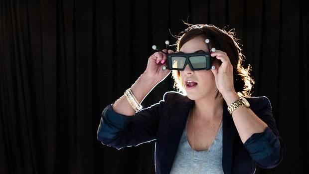 "A visitor to Reality Cave Inc. in Kitchener, Ont., puts on special sensor ""tracking"" glasses before stepping into the theatre-like booth (5.6 metres wide, three metres tall and three metres deep). (Scott McQuarrie/re:actionphotography)"