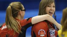 Canada's skip Rachel Homan and second Alison Kreviazuk (L) celebrate after defeating Sweden at the World Women's Curling Championships in Saint John, New Brunswick, March 20, 2014. (MATHIEU BELANGER/Reuters)