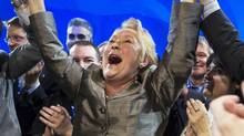 Pauline Marois, leader of Parti Quebecois, celebrates the result of her leadership review vote at the party's national convention in Montreal, April 16, 2011. The party affirmed her leadership by a vote of 93.08%. (Christinne Muschi/ Reuters/Christinne Muschi/ Reuters)