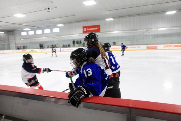 Nunavik Nordiks Noemie Koneak (13) is checked into the boards during a game March 24, 2017 in Ottawa. The Inuit girl's hockey team is in Ottawa for a tournament. DAVE CHAN / THE GLOBE AND MAIL