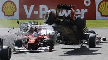Lotus Formula One driver Romain Grosjean (R) of France crashes with Ferrari Formula One driver Fernando Alonso (L) of Spain at the start of the Belgian Grand Prix in Spa Francorchamps September 2, 2012. (STRINGER/BELGIUM/REUTERS)