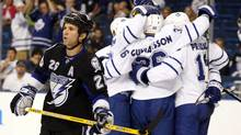 Tampa Bay Lightning's Martin St. Louis reacts as members of the Toronto Maple Leafs celebrate a goal during the first period of their NHL hockey game in Tampa, November 25, 2009. (MIKE CARLSON)