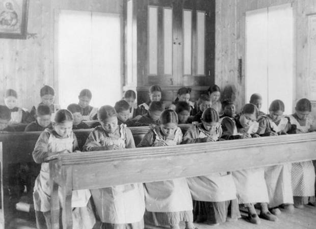 In this handout photo, students are seen in a Northwest Territories classroom within the Fort Resolution Indian Residential School system, a program which has spurred over a decade of reparation cases.