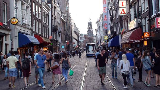 The Netherlands pioneered the concept of the 'living yard,' where pedestrians and cyclists share the road with vehicles moving at a walking pace.