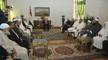 Egypt's President Mohamed Mursi meets with Egyptian Islamic scholars and preachers at the Presidential Palace in Cairo November 7, 2012. (HANDOUT/REUTERS)