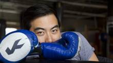 "Yung Chang, producer of the movie ""China Heavyweight,"" poses at the Blue Cat Boxing Gym in Montreal on May 8, 2012. (Christinne Muschi For The Globe and Mail)"