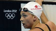 Canada Julia Wilkinson competes in the women's 100-metre backstroke heat at the Aquatic Centre in the Olympic Village at the 2012 Summer Olympics in London on Sunday, July 29, 2012. (The Canadian Press)