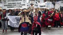 Protesters from the Heiltsuk First Nation march in Vancouver during a rally against the proposed Northern Gateway pipeline on March 26, 2012. (John Lehmann/The Globe and Mail)