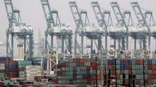 In this Tuesday, Dec. 4, 2012, file photo, shipping containers are seen at the Port of Los Angeles. (Nick Ut/AP)