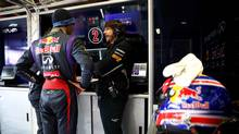 Mark Webber (L) of Australia and Infiniti Red Bull Racing chats with Canadian performance engineer Gavin Ward as he prepares to drive during day one of Formula One winter test at the Circuit de Catalunya on February 28, 2013 in Montmelo, Spain. (Mark Thompson/Red Bull)