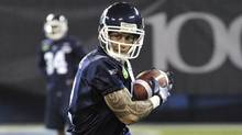 Toronto Argonauts kick returner Chad Owens runs a play during practise ahead of the 100th Grey Cup CFL football game in Toronto, November 23, 2012. (Reuters)