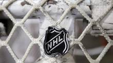 The NHL logo is seen on a goal at a Nashville Predators practice rink on Monday, Sept. 17, 2012, in Nashville, Tenn. The NHL locked out its players at midnight Saturday, the fourth shutdown for the NHL since 1992. (Mark Humphrey/AP)