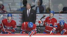 Montreal Canadiens head coach Michel Therrien and players, from left, Lars Eller, Alex Galchenyuk and Brian Gionta look on from the bench during third period NHL action against the Toronto Maple Leafs in Montreal, Saturday, February 9, 2013. The Leafs won 6-0. (Graham Hughes/THE CANADIAN PRESS)
