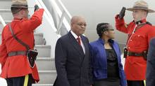 South African President Jacob Zuma, and his daughter Phumzile, are greeted by Royal Canadian Mounted Police as they arrive in advance of the G8 and G20 Summit, Thursday, June 24, 2010, at Pearson International Airport in Toronto. (Gerry Broome/AP)