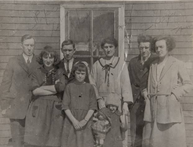 One of Mrs. Chapman's family photos shows her mother, back row centre, father, back row left, and siblings taken a few years after the explosion. Mrs. Chapman is second from left in the front row.
