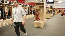 Calgary Stampeders Wes Lysack walks through the locker room during a media tour of the team's new facilities in Calgary, Monday, June 14, 2010. (Jeff McIntosh/THE CANADIAN PRESS)