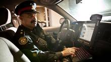 Inspector Riyaz Hussein of the Toronto Police Service is seen inside a Toronto Police Service patrol car. (Jennifer Roberts for the Globe and Mail/Jennifer Roberts for the Globe and Mail)