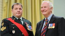 Governor General David Johnston presents the medal of Military Valour to Sergeant Graham Marc Verrier of Winnipeg, Man., during a ceremony at Rideau Hall in Ottawa on Thursday, January 26, 2012. (Sean Kilpatrick/The Canadian Press/Sean Kilpatrick/The Canadian Press)