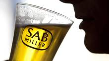 A glass of beer produced by SABMiller PLC is seen in this undated company photo released to the media in 2011. A plan by Miller Brewing Co., a subsidiary of SABMiller PLC, to terminate its Canadian licensing agreement with Molson Coors suffered a legal setback Thursday when an Ontario court granted a temporary injunction that prevents the termination until a trial on the matter scheduled for later this year. (Jason Alden/SABMiller)