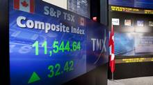 The screens at the TMX Broadcast Centre in Toronto show the closing numbers of the TSX on July 11, 2012. (Matthew Sherwood For The Globe and Mail)