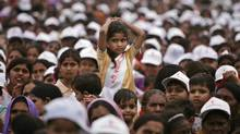 A girl amongst the audience looks on during an event against female feticide organized by Delhi Commission for Women, in New Delhi, India. (GURINDER OSAN)