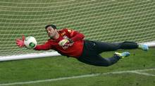 Brazil's national soccer team goalkeeper Julio Cesar dives for the ball during a training session in Rio de Janeiro June 28, 2013. (PILAR OLIVARES/REUTERS)