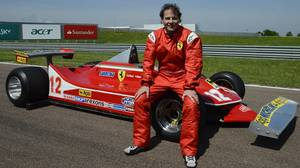 Jacques Villeneuve poses with his father's car.
