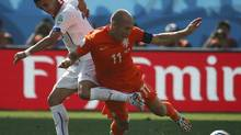 Chile's Alexis Sanchez, left, fouls Arjen Robben of the Netherlands during their 2014 World Cup Group B soccer match at the Corinthians arena in Sao Paulo June 23, 2014. (Sergio Moraes/REUTERS)