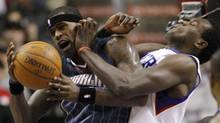 Charlotte Bobcats' Stephen Jackson, left, tries to get a shot past Philadelphia 76ers' Samuel Dalembert in the first half of an NBA basketball game, Wednesday, March 10, 2010, in Philadelphia. (AP Photo/Matt Slocum) (Matt Slocum)