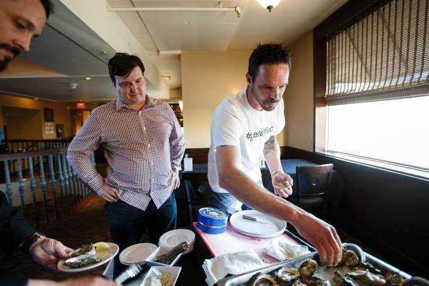 Rob Tryon of Effing Seafoods (right) shucks oysters at Von's Steakhouse in Edmonton, Alta, on Wednesday, April 27, 2016.