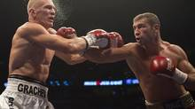 Lucian Bute, left, from Montreal, lands a right to the head of Denis Grachev, from Russia, during their North American Boxing Federaton light heavyweight title fight Saturday, November 3, 2012 in Montreal. Bute won on a unanimous decision. (Ryan Remiorz/THE CANADIAN PRESS)
