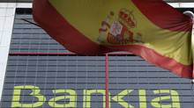 A Spanish flag flutters beside nationalized lender Bankia's headquarters in Madrid May 30, 2012 (SERGIO PEREZ/REUTERS)