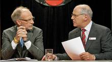 CBC president and CEO Hubert LaCroix, left, talks to Tim Casgrain in Ottawa, Sept. 23, 2009. Mr. Casgrain is stepping down as chair of the CBC's board of directors. (Pawel Dwulit / CP)