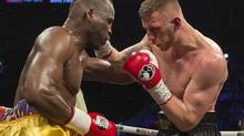 Adonis Stevenson left, and Andrzej Fonfara battle in a WBC light heavyweight title bout in Montreal on May 24. (Peter Mccabe/THE CANADIAN PRESS)