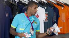 Brazilian Olympic footballer Juan Jesus shops in a store in the Athletes Village in London July 22. (Neil Hall/Reuters)