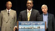 Detroit's emergency financial manager Kevyn Orr, centre, addresses the media as Mayor Dave Bing, left, and Michigan Governor Rick Snyder listen, at Cadillac Place in Detroit, March 14, 2013. (REBECCA COOK/REUTERS)
