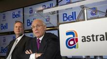 BCE president and chief executive officer George Cope, left, and Ian Greenberg, president and CEO of Astral Media Inc., speak at a news conference in Montreal in this March 16, 2012 file photo. (CHRISTINNE MUSCHI/REUTERS)