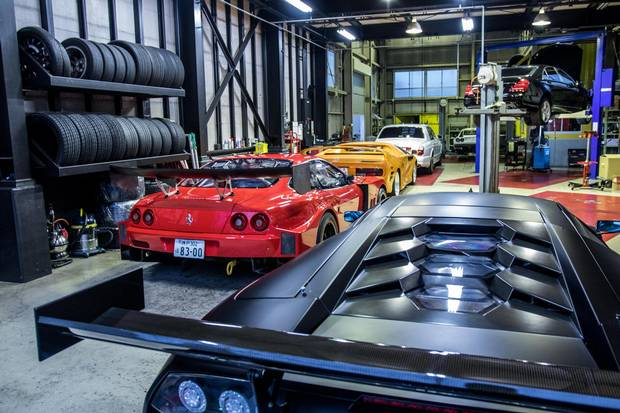 Tucked away in a Hiroshima garage, a multitude of ultra-rare supercars all carry street signs.