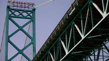 The Ambassador Bridge spans the Detroit River dividing Canada and the U.S., is shown on Friday June 15, 2012. (Mark Spowart/THE CANADIAN PRESS)