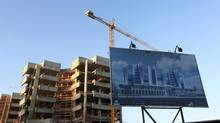 A billboard advertising an administrative office complex project is erected in front of the construction site in Benghazi Jan. 19, 2013. (ESAM OMRAN AL-FETORI/REUTERS)